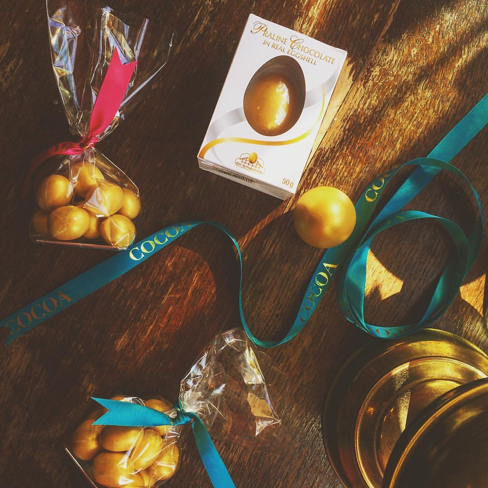 Golden Champagne truffle eggs £4/100g, Praline filled real gold egg shell £3.60