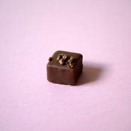 popping strawberry champagne truffle in milk chocolate