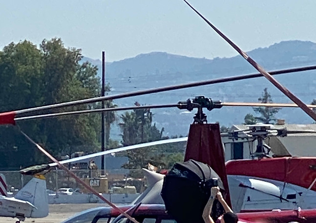 Crew on the helicopter tarmac prepping the poacher scene.   Image Giselle Joves.