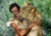 TONY FITZJOHN and lion.jpg