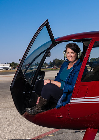 Phyllis ready to fly to shoot from inside this helicopter.   Image Moses Sparks.
