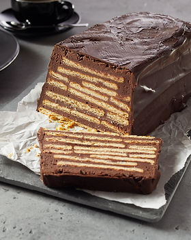 Bar-shaped chocolate cake with biscuits
