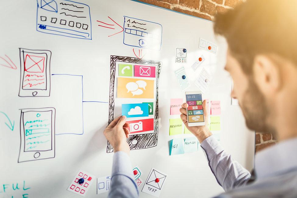 Designer man drawing website ux app deve