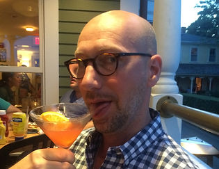 picture of someone drinking a cocktail