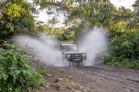 Splashing water | Vehicle driving through a stream | Kiboko Lodge | Shots and Tales | Tanzania