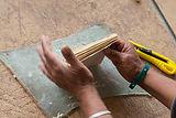 Hands of Nepali woman making Lokta Paper Notebooks in Nangi, Nepal