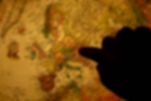 Finger pointing at a World Globe