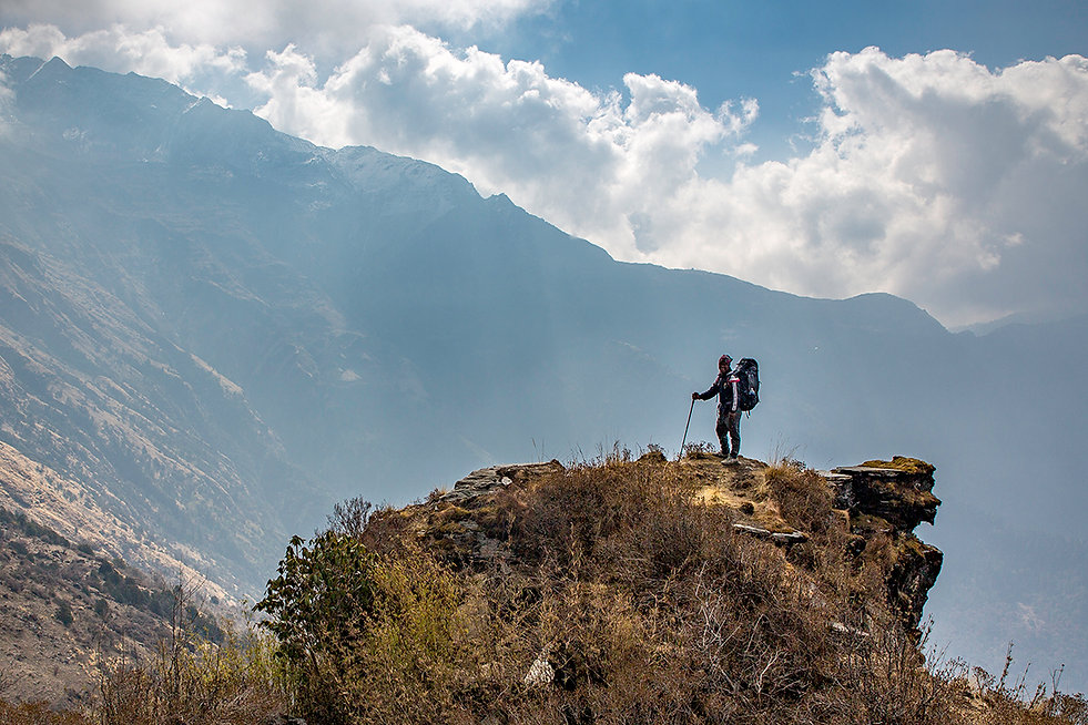 Porter carrying bags whilst trekking in the Annapurna-Dhaulagiri Community Trail, Nepal