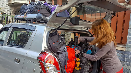 Loading the taxi up with trekking gear, Start of Annapurna-Dhaulagiri Community Trail, Nepal