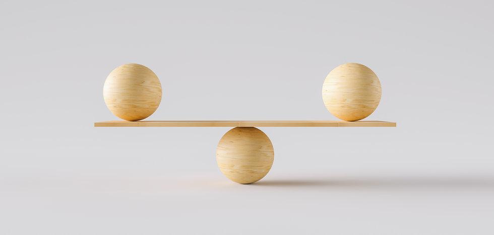 wooden scale balancing two big wodden ba