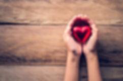hands female giving red heart.jpg