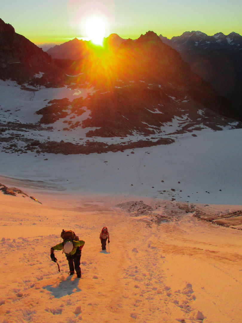 Sunrise approaching the Bugaboo-Snowpatch Col
