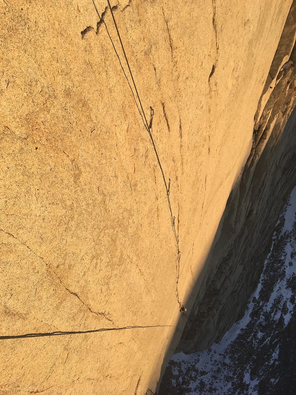 Matt chasing the sunset up a headwall splitter