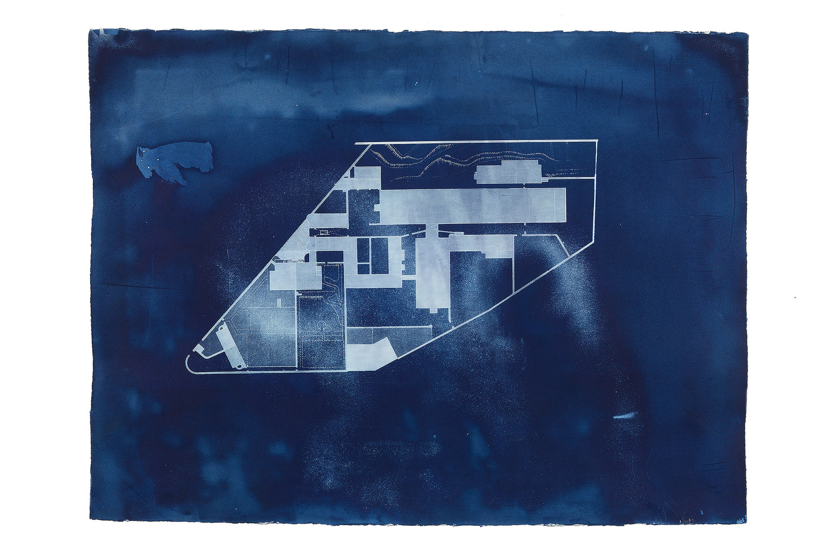 """5 0. 4 7 4 9°  N,  4. 7 2 8 6°  W  [E D I T I O N  1]  2 0 1 4 C Y A N O T Y P E  2 3  x  3 3 """"   A series of cyanotypes of Bodmin Jail made in conjunction with the project '12 Hour Cell'. This collaboration with Lucy Crump shows floor plans of the prison before and after it's extension to accommodate more inmates."""