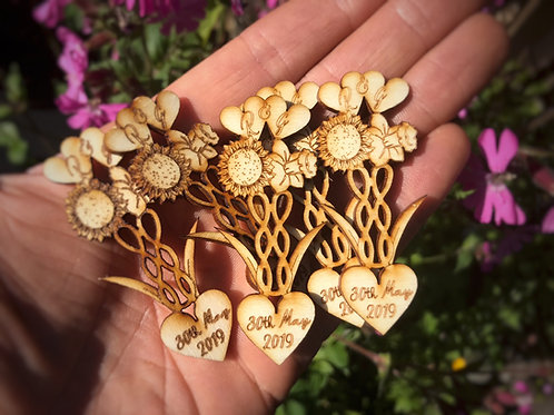 Welsh love spoon wedding favours personalised with your wedding flowers