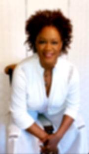 Rhonda white top white background leanin