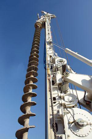 4341711-closeup-shot-of-vertical-drilling-rig-against-blue-sky