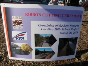 The ribbon cutting sign