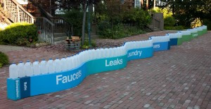 This 72-foot long installation with 153 one-gallon water bottles represents the average daily water use per person in the Santa Clara Valley. The different colors show what percentage of the water is used for different purposes.   Photo credit: Joel Bartlett
