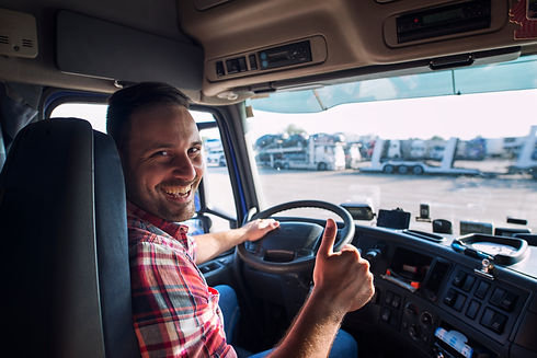 portrait-of-truck-driver-sitting-in-his-