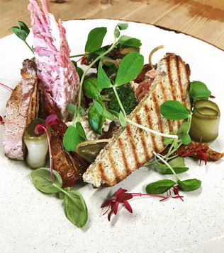 Ham hock terrine served with a celeriac remoulade, sun dried tomatoes and caper berries.