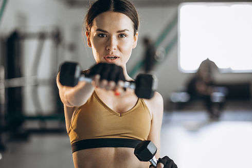 attractive-young-woman-exercising-with-d