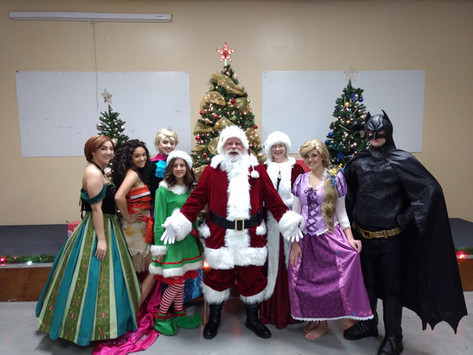 Santa and Mrs. Claus with Princesses and Superheroes