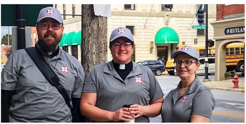Pastor John Longworth, Pastor Hannah Rogers, Diane Sharrow wearing Faith on Foot uniforms