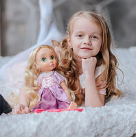 Adorable toddler girl with blond curly h