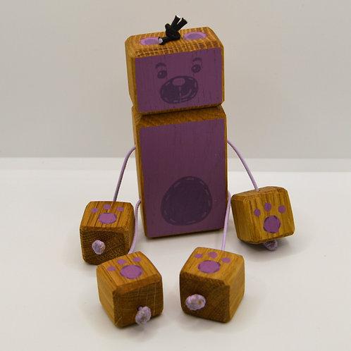 Purple teddy bear doll