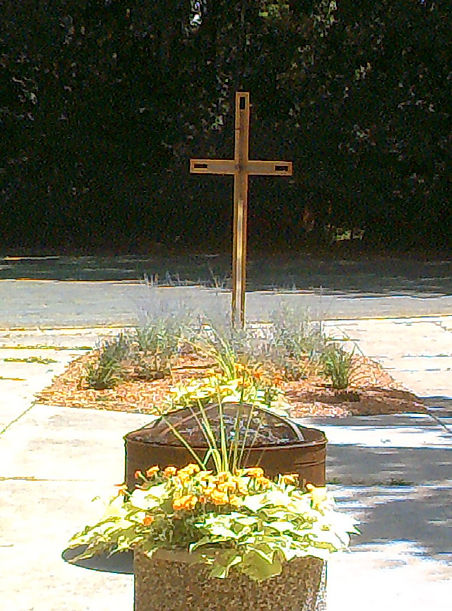 Advent Lutheran Boyscout garden with large wood-metal cross