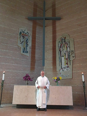 Pastor Matthew Basich in front of altar at Advent Lutheran Church