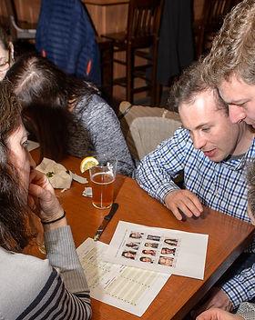 People_enjoying_trivia_at_a_bar_1600x.jpg