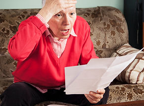 Senior old woman shocked with the bills