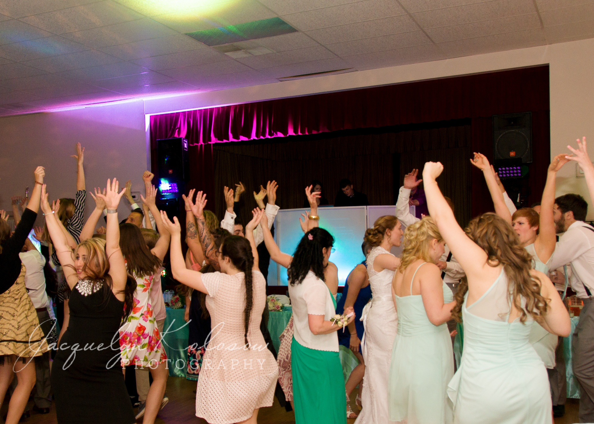 Hands up! Our wedding DJs pack floor