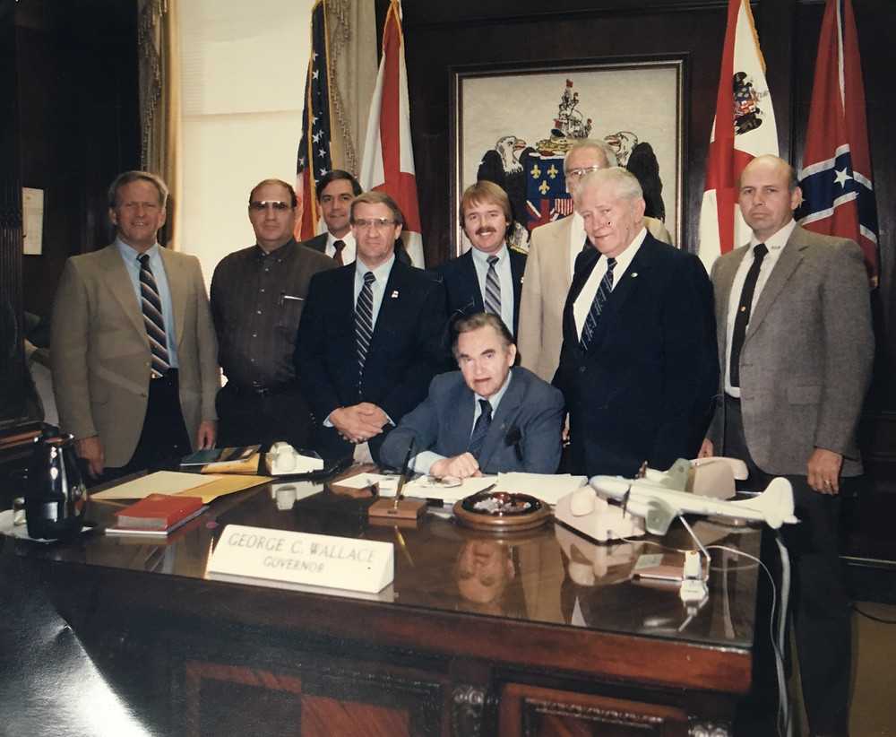 L-R: Rep. Butch Ellis, Donald Wilson, Joey Ray, Kin Logan, Mike Davis, Governor George Wallace, RC Farmer, Rep. A.J. Blake, Robert Beason