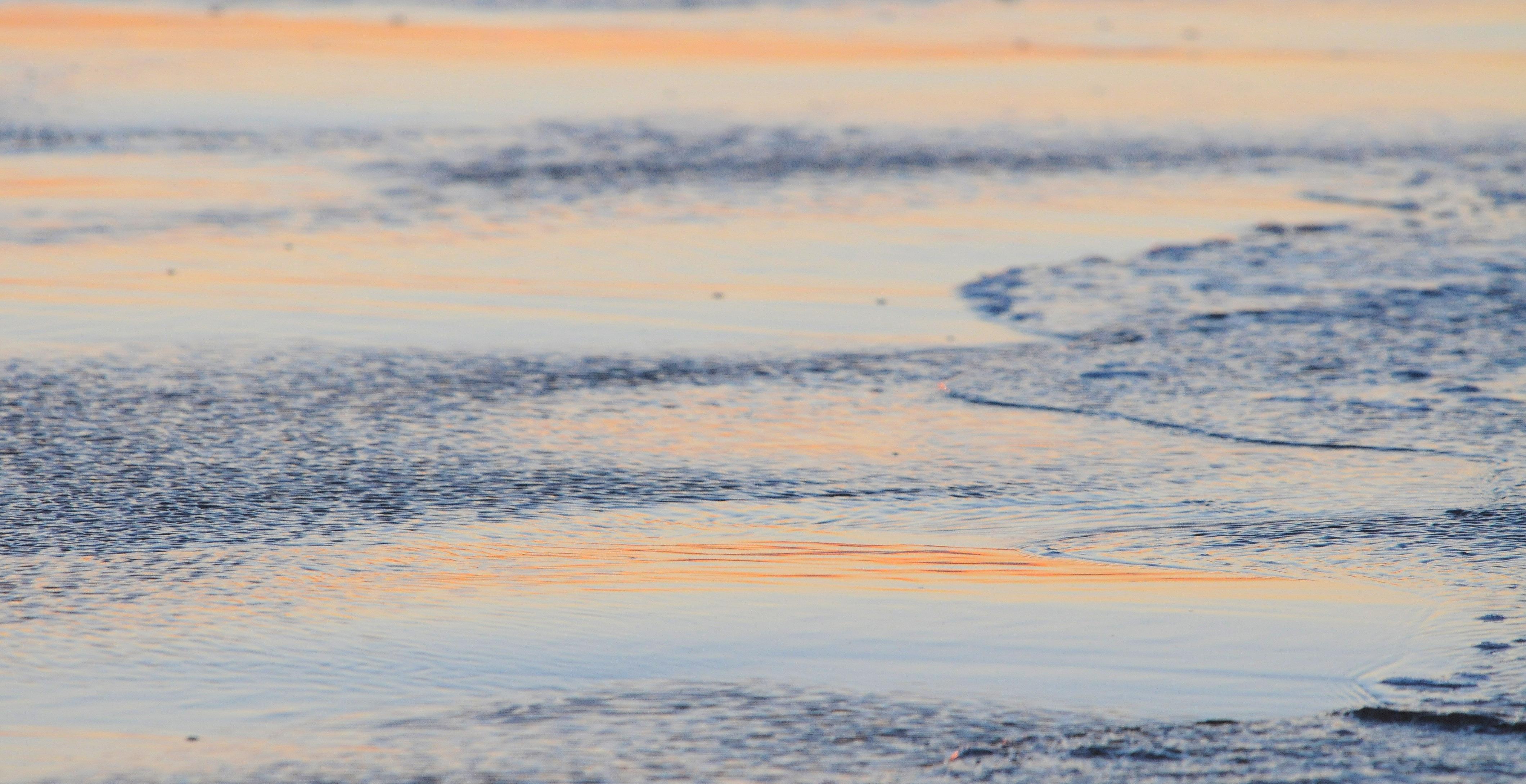 Abendrot im seichten Wasser ©Johannes Ratermann