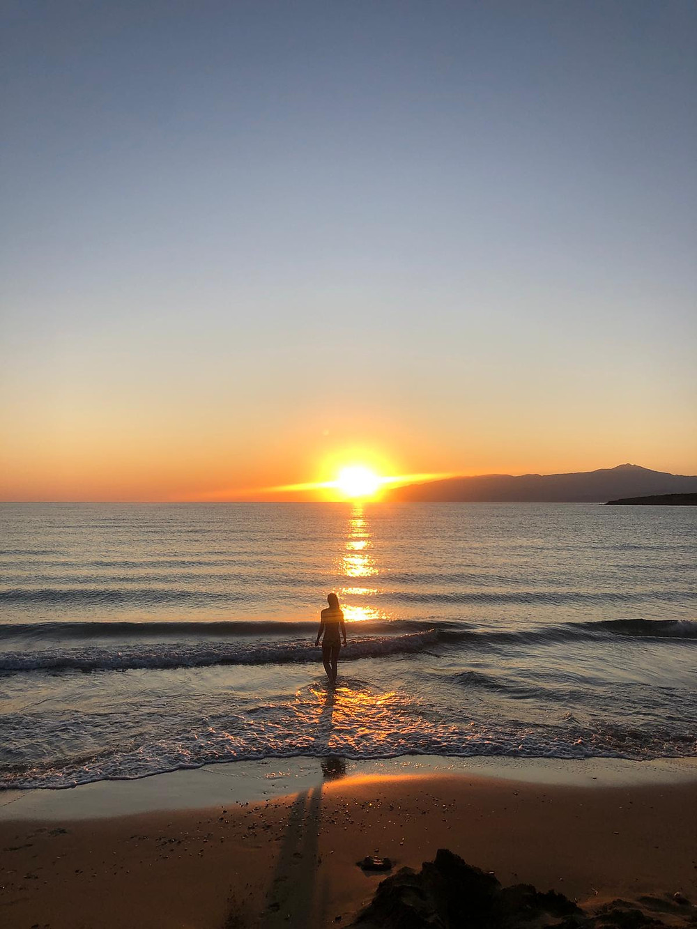 Swimming during sunrise, at the beach that is right across the Retreat Center