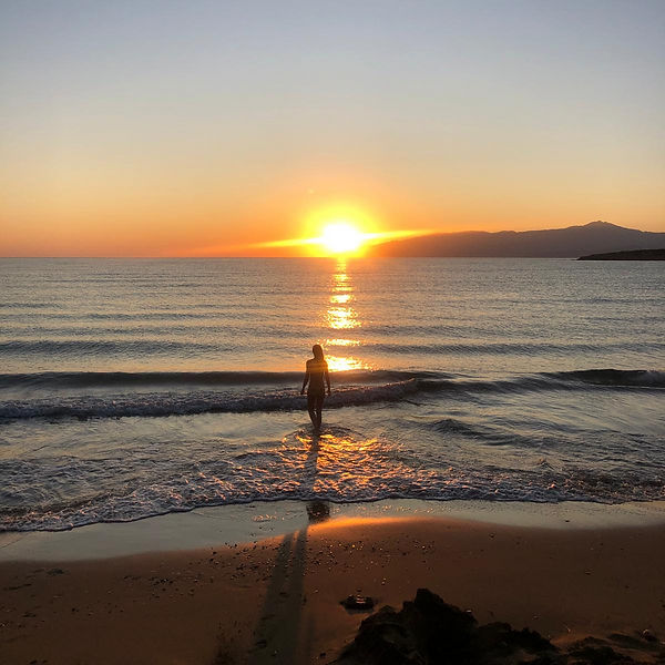Swimming during sunrise, at the beach th