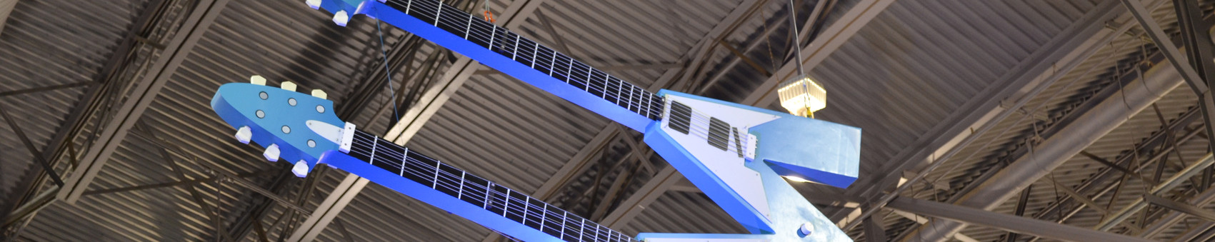 """A custom hanging """"M"""" guitar made for Medrio that I designed"""