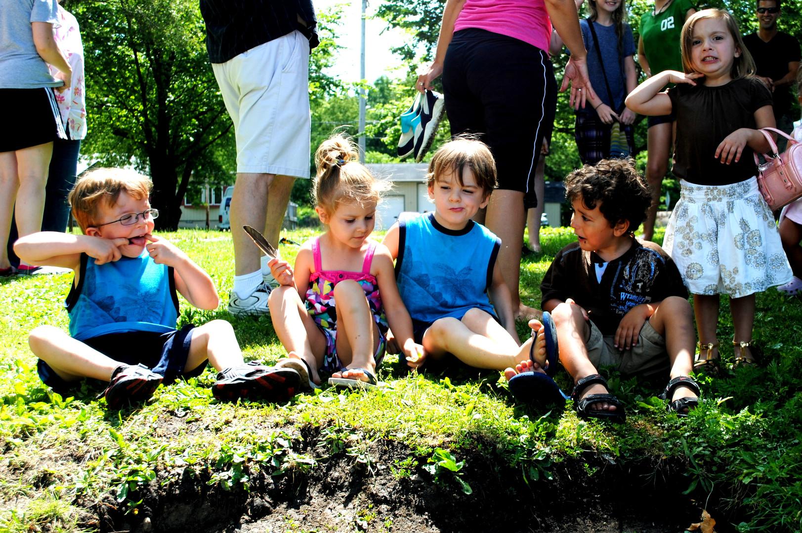Baptism Service - Kids sitting in the grass.jpg