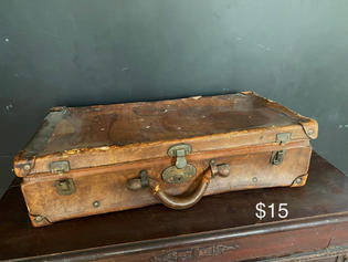 Leather suitcase.  Lost of charm