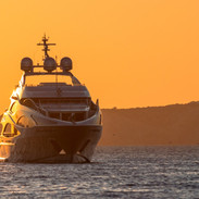 luxury-yacht-at-sunset-picture-id8786509