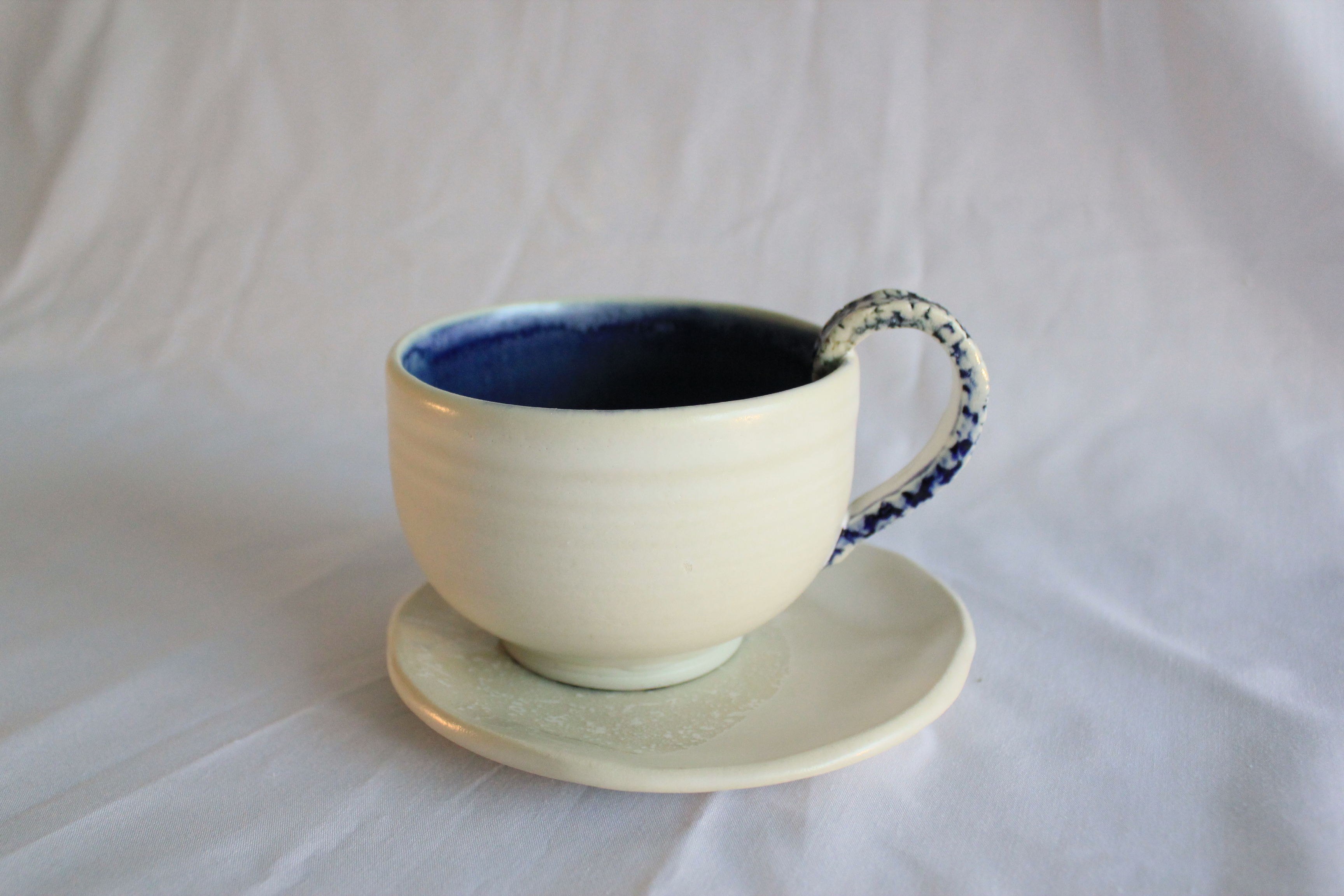 Blue teacup and saucer
