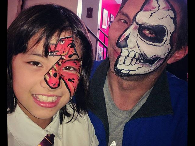Dad and daughter time! #halloween #facepaint #makeup #fun #party #dragon #skullmakeup #cooldad #dadanddaughtertime #awesome #toocute #mehron