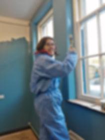 Volunteer painting at Ragtag Arts and Community Scrapstore, near Kendal