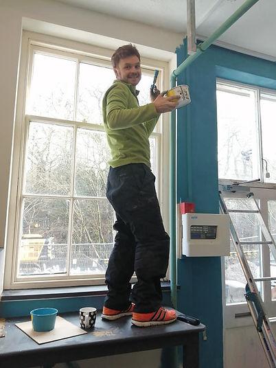 Josh decorating Ragtag Community Scrapstore