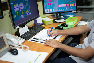 Male employees write notes work in produ