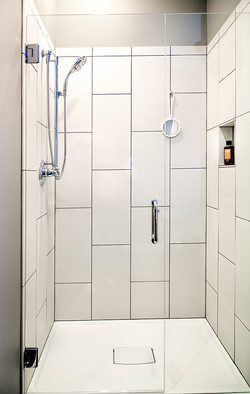 Hook to hang a shower mirror