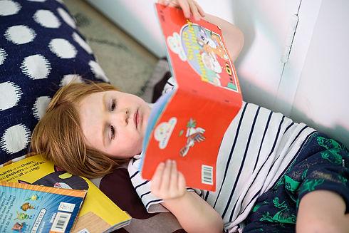 Child reading a book at World Tower Child Care Sydney CBD